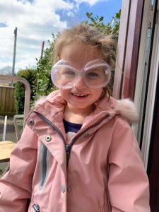 Emily wearing safety goggles for our volcano experiment