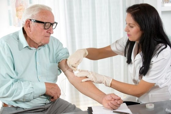Photo of a man having blood drawn
