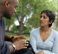 Man and woman talking in park