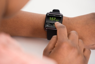 Person checking a smartwatch on left wrist.