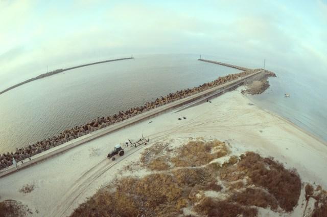 Raminantis jūros vartų peizažas