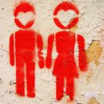 Grafitti man en vrouw in rood op een muur, copyright Dariusz Bargiel
