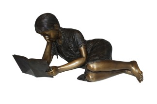 "Girl laying reading a book Bronze Statue -  Size: 36""L x 17""W x 18""H."