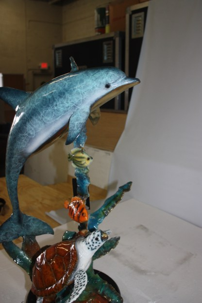 """Dolphin with two fish and one turtle Statue -  Size: 22""""L x 12""""W x 32""""H."""