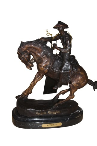 "Remington Cowboy on marble Bronze Statue -  Size: 10""L x 3.5""W x 10""H."