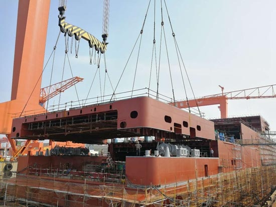 One of the stern sections for E-Flexer #1 being lifted into place at AVIC Weihai. AVIC Weihai.