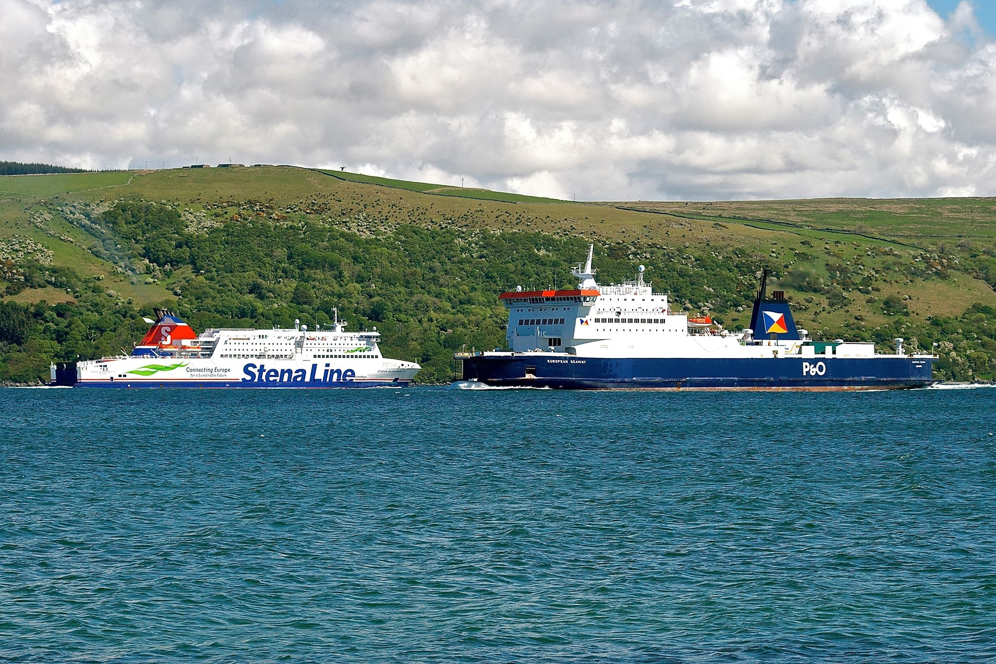 Stena Line's STENA SUPERFAST VII and P&O Ferries' EUROPEAN SEAWAY meet in Loch Ryan, 21.05.19. The latter vessel was on relief vessel duties covering for EUROPEAN HIGHLANDER which was in dry dock at Cammell Laird Birkenhead. Copyright © Gordon Hislip.