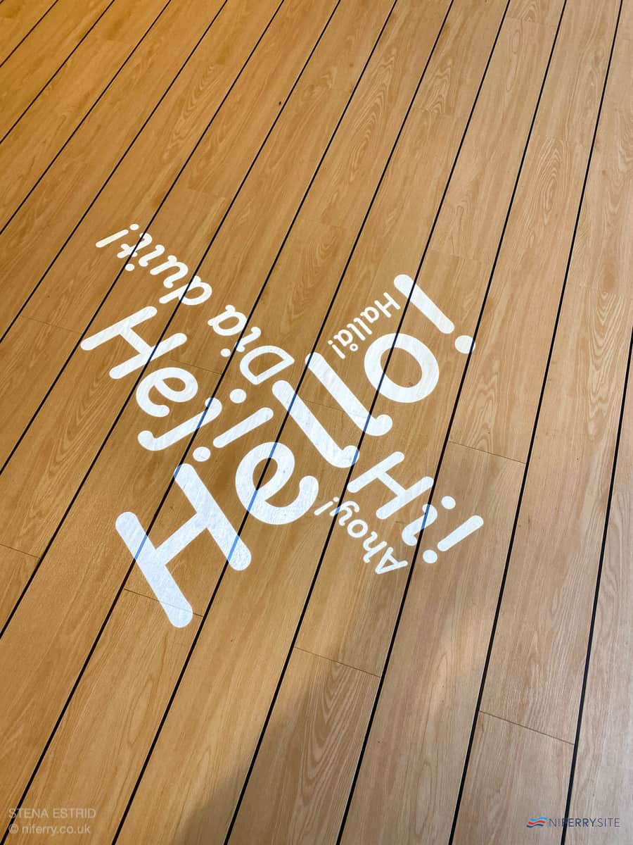 Close-up of the message projected onto the floor from the deckhead above in front of guest services. © NIferry.co.uk