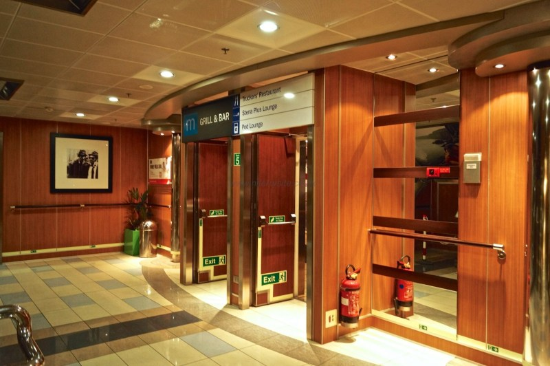 The 2 main walkways through Barista merge here in-front of the staircase to the main cabin deck. These double doors lead to the pod lounge, Stena Plus, and then the Met Bar and Grill, as well as the truckers restaurant. © NIFerrySite