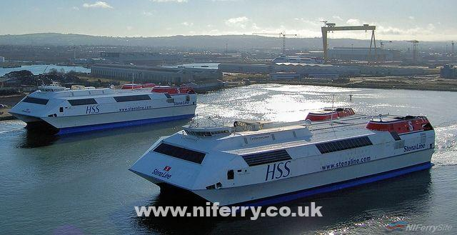 """HSS Explorer passing HSS Voyager, which is at Harland and Wolff's ship repair quay. Stena Discovery is just just visible under the massive yellow """"samson"""" crane in the background. Copyright © Alan Geddes."""