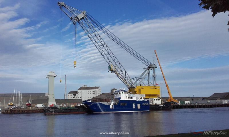 Spirit of Rathlin rests in the River Avoca following her 'launch' by the crane barge Lara I. Courtesy of Arklow Marine Services.