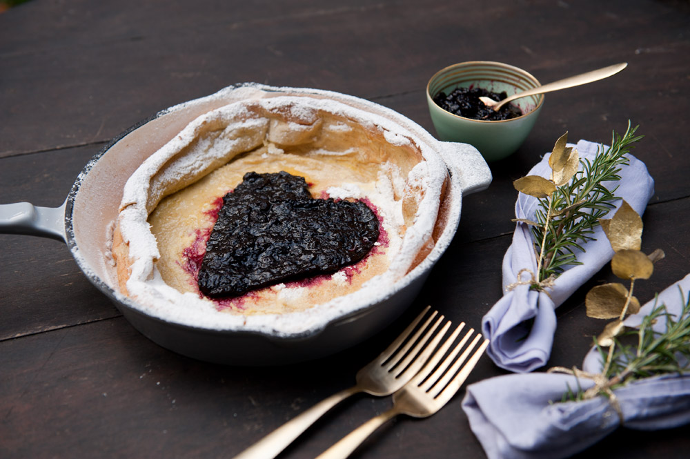 Delicious Dutch Baby Pancake with Blueberry Sauce from {nifty thrifty things}