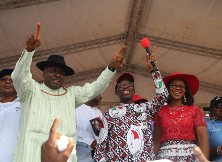 Delta State Governor, Senator Ifeanyi Okowa (2nd left); his wife, Dame Edith (right); Deputy Governor of Delta State, Barr. Kingsley Otuaro (left) and former Governor of Delta State, Chief James Ibori, during the Peoples Democratic Party (PDP) Campaign Flag Off, at Oghara Township Stadium, Delta State. PIX; JIBUNOR SAMUEL.