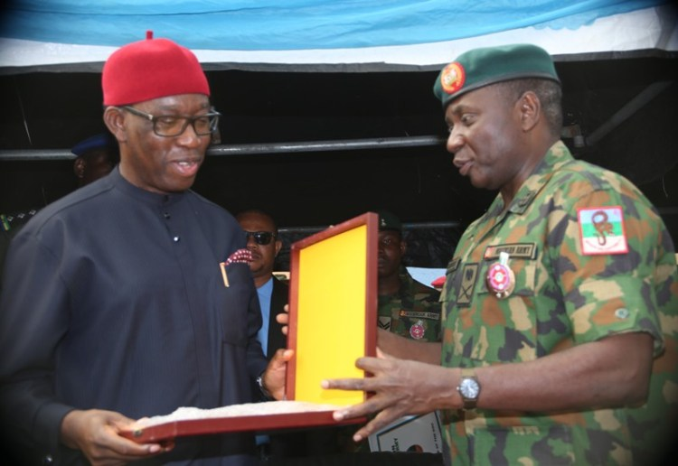 Delta State Governor, Senator Ifeanyi Okowa (left), receiving an appreciation plaque from the General Officer Commanding 6 Division Nigerian Army/Land Component Commander JTF, Major General Jamin Sarham, representing the Chief of Army Staff, during the inauguration of 63 Brigade, Nigerian Army in Asasba. PIX: BRIPIN ENARUSAI