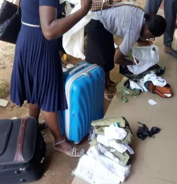 The two female corps members being dekitted before being sent home