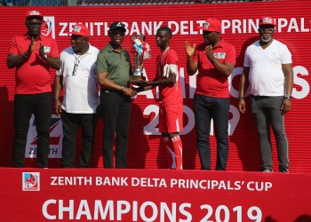 Delta State Governor, Senator Dr. Ifeanyi Okowa (3rd left); presenting the Trophy to the Captain, College of Commerce, Warri, winners of the 2019/2020 edition of Zenith Bank Delta Principals'' Cup. With him is the Speaker, Delta State House of Assembly, Rt. Hon. Sheriff Oborevwori (2nd left); President, Nigeria football Federation, Amaju Pinnick (right); Delta State PDP Chairman, Barr. Kingsley Esiso (left) and the Executive Director, Zenith Bank, Mr. Henry Okoh, at the Stephen Keshi Stadium, Asaba on Thursday, 28/11/19. PIX: DELTA GOVT HOUSE