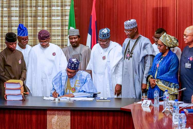 President Muhammadu Buhari flanked by the leadership of the National Assembly and members of the National Executive Council during the signing into of the 2020 Appropriation Bill onTuesday