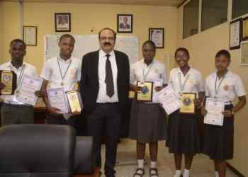 Managing Director and CEO of Premium Steel and Mines Limited, Mr. Prasanta Mishra (3rd from left) with winners of the Delta State 2020 Science Olympiad from the Premium (DSC) Technical High School at the company premises in Udu on Wednesday.