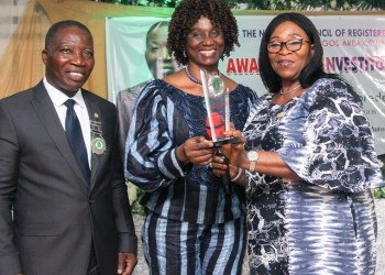 L-R: NCRIB(LAC): Chairman, NCRIB(LAC), Mr. Rotimi Olukorede; immediate past chairman, Mrs. Bukola Ifemade, presenting and awrad to the first President of NCRIB, Barr. Laide Osijo after the investiture of Olukorede as the new chairman of the Nigeria Council of Registered Insurance Brokers( Lagos Area Committee.