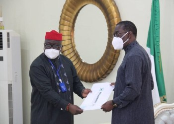 DESOPADEC MD, Bashorun Askia Ogieh presenting letter of condolence to Governor Ifeanyi Okowa on behalf of the board