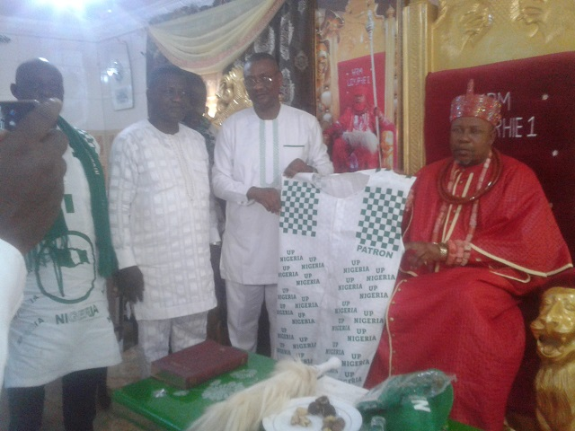 Ovie of Idjerhe Kingdom being decorated by the leadership of the Nigeria Football Supporters Club weekend.
