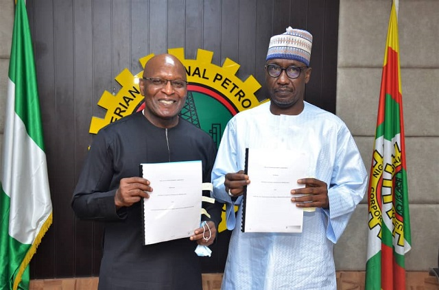 (From Left) Group Managing Director of SEEPCO, Mr Tony Chukwueke with Group Managing Director, NNPC, Mallam Mele Kyari at signing of OML 143 Gas Development Deal