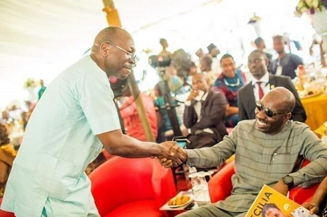 Pastor Ize-Iyamu in handshake with Governor Godwin Obaseki