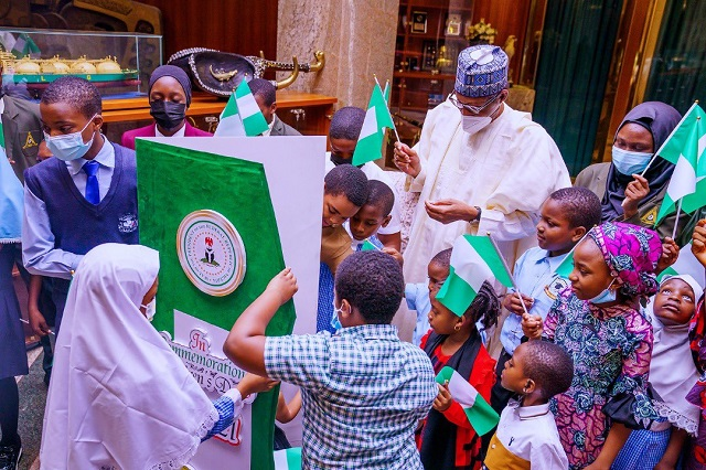 President Buhari celebrating the Children's Day with some Nigerian Children in Abuja on Thursday