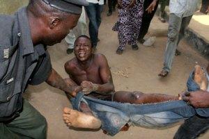 Police brutalizing a suspect