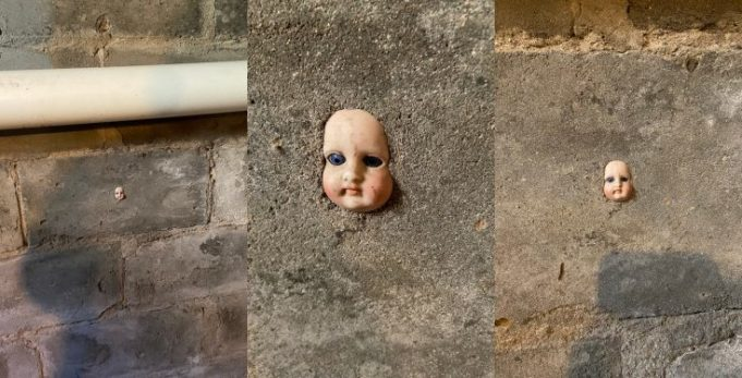 Woman finds head of a doll stuck in her basement wall 681x347 1