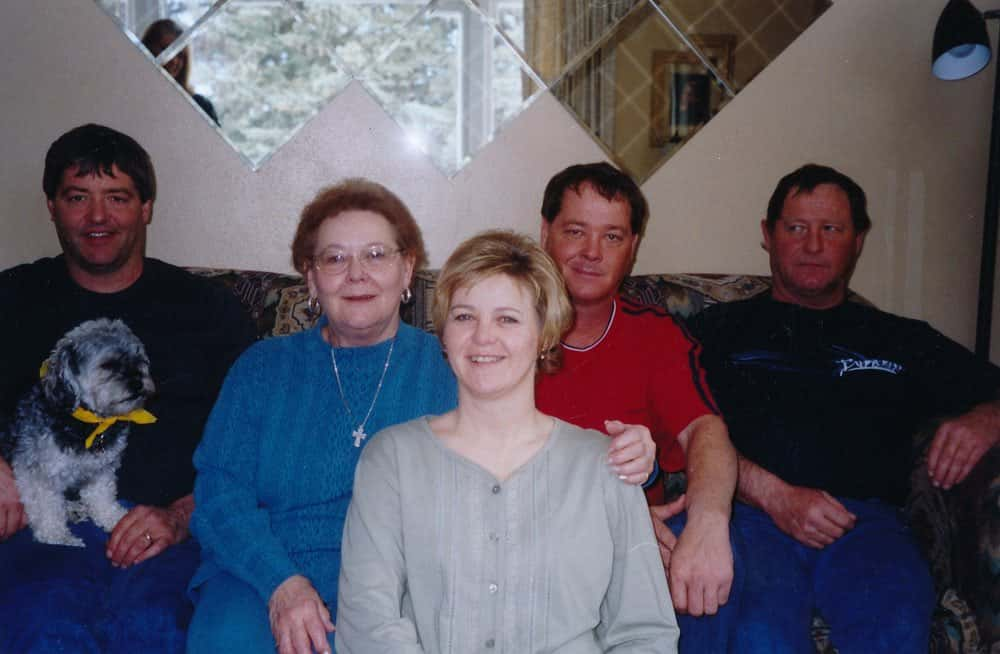 Karla (center) with her mother and brothers. From left to right: Dean, Doug, and Brian.