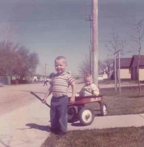 Doug pulling Dean in a wagon. Growing up, the two boys were inseparable.