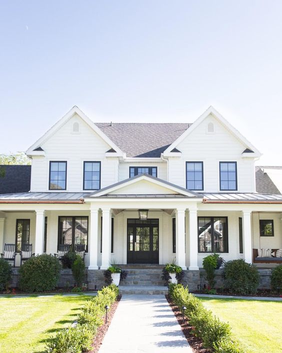 This all-white farmhouse style home exterior is so simple and classic, it's a must-have!