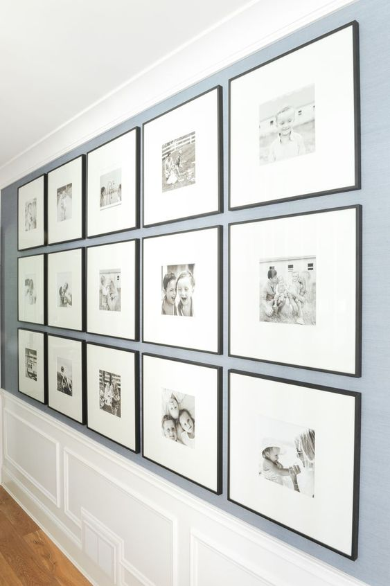 DIY photo gallery wall idea to help you design the best piece of art in your home! Black and white, large, black frames, full wall - #blackframes #largegallerywall #blackandwhitephotos || Nikki's Plate