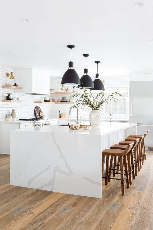 15 White Kitchen Designs You Haven't Seen Yet! Beautiful white kitchen inspiration for your remodel. Marble Countertop, black pendant light, island, bright white #whitekitchen #modern