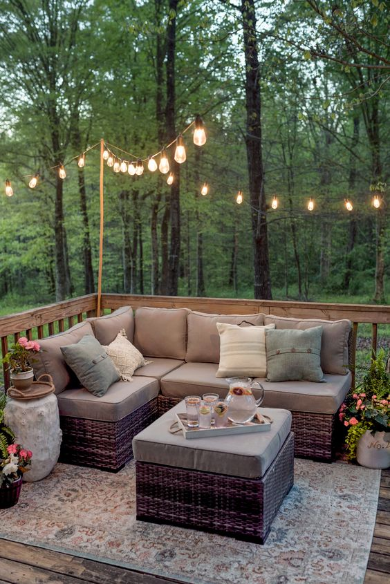 15 Deck Must Haves for Summer Entertaining; string outdoor lights, Edison lights, outdoor sectional, comfy seating