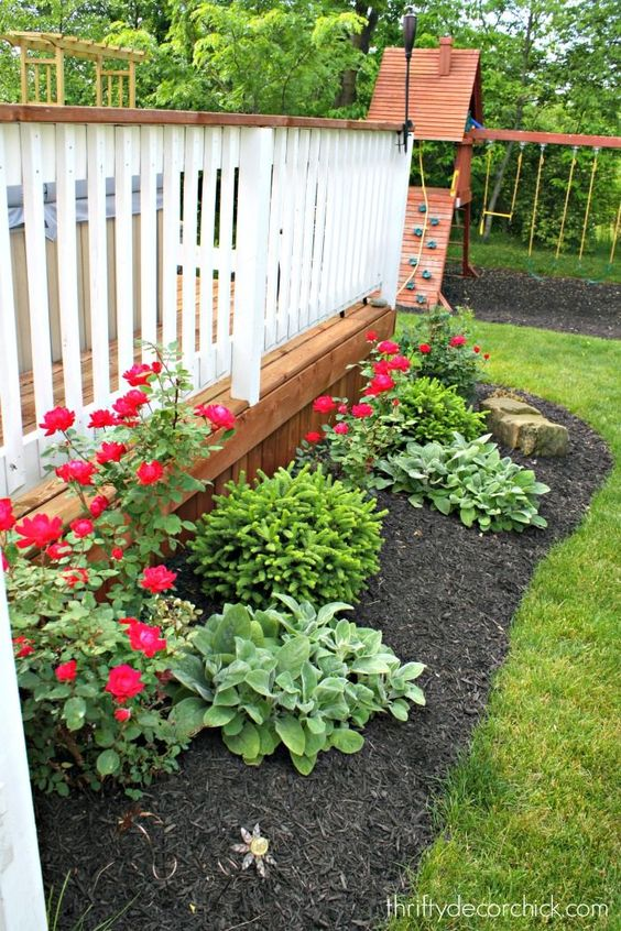 15 Deck Must Haves for Summer Entertaining; deck landscaping, deck garden, black mulch