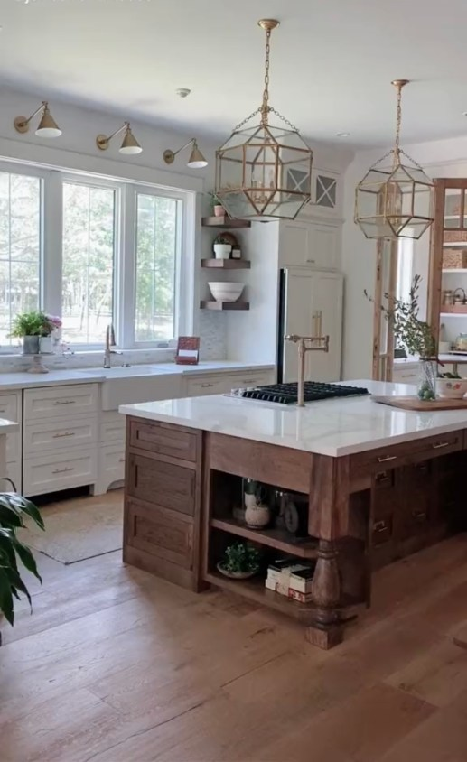 Best Home Decor Instagram Accounts You Should Be Following; White kitchen, gold pendents, farmhouse