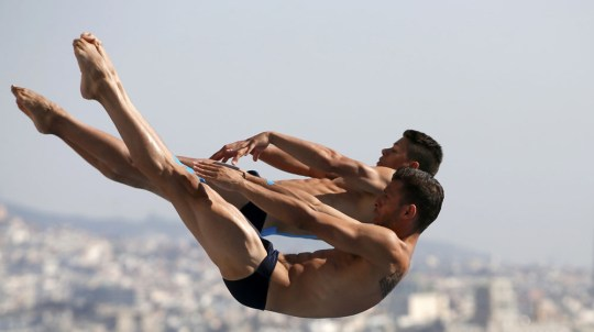 Greece's Paparounas and Fafalis perform a dive at the men's synchronised 3m springboard preliminary during the World Swimming Championships in Barcelona