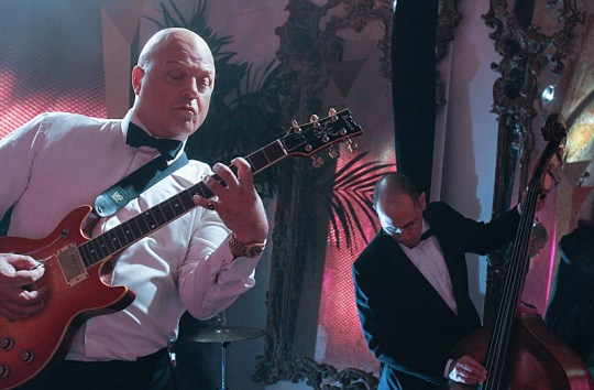"""Past Lives"" --Michael Chiklis takes a break between scenes to jam with the band, on VEGAS Friday, April 26 (9:00-10:00 PM, ET/PT) on the CBS Television Network. Photo: Cliff Lipson/CBS © 2013 CBS Broadcasting, Inc. All Rights Reserved."