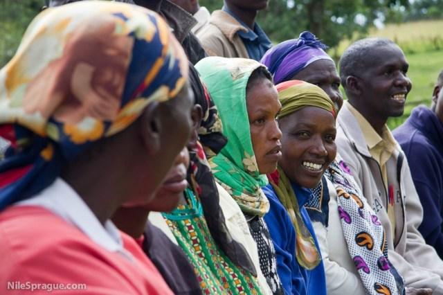 Women of Tiret Self-Help Group passion fruit farmers cooperative watching presentation, Project Nurture, Tiret, Kenya.