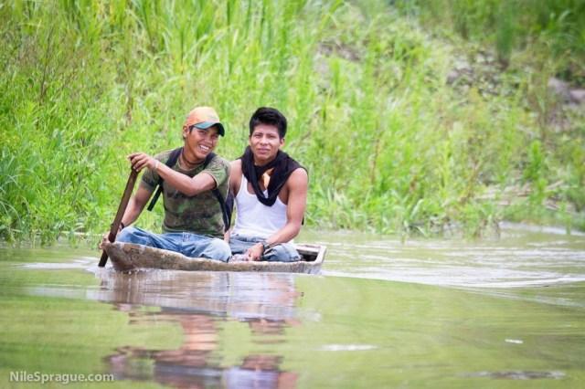 Men in Dugout Canoe on Amazon River, near Iquitos, Peru