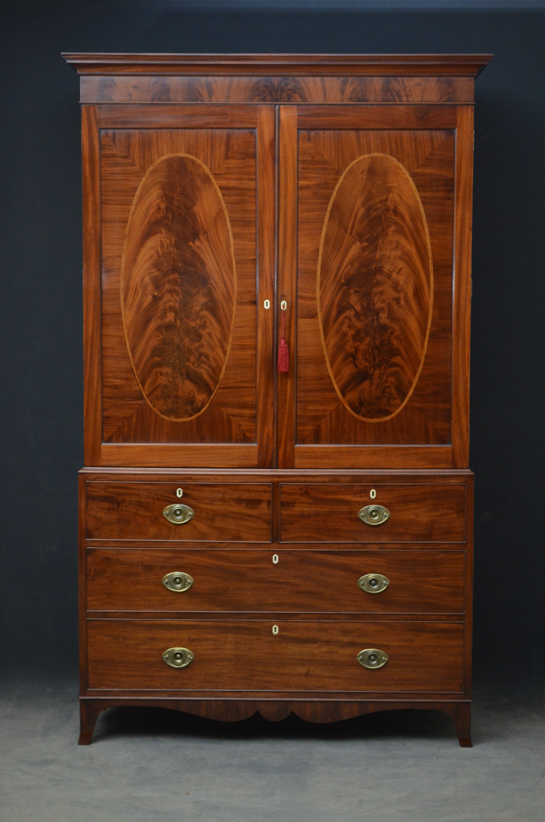 Mahogany wardrobe and linen press.