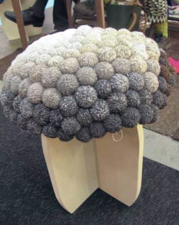A most odd creation. The seat is created from small knitted balls. More odd than beatiful.