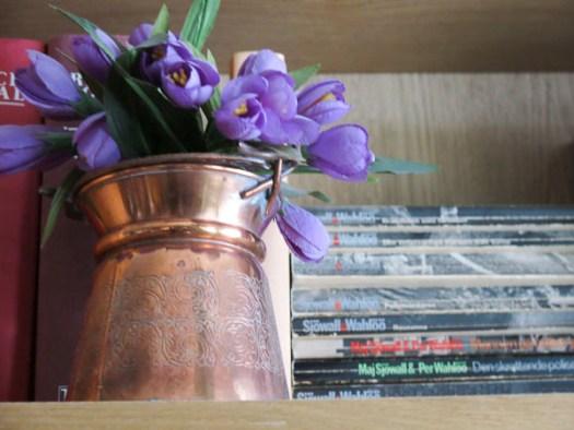 coppervase, fake crocus, books, bookcase