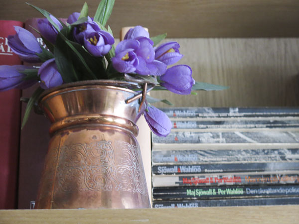 coppervase, fake crocus, books, bookcase