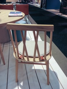 A chair with an interesting back and an interesting way of fastening the soft seat-cover
