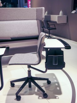 A chair with a table at its back thatt could be swung around