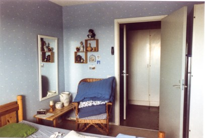 The bedroom, view out to the hallway.