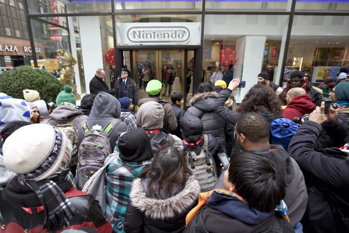 In this photo provided by Nintendo of America, Nintendo fans eagerly await to enter the grand reopening of the remodeled Nintendo NY store on 19th February 2016.